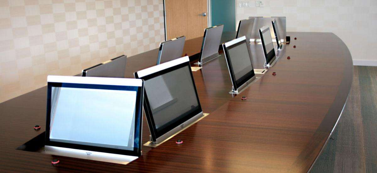 Custom Conference Table Hides Impressive AV System in Executive Boardroom
